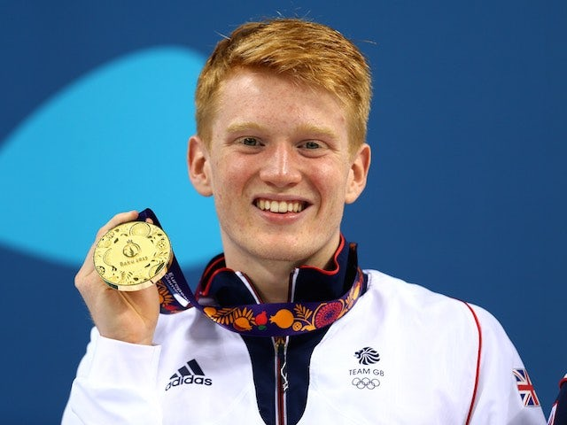 Team GB diver James Heatly poses with his gold medal at the European Games on June 20, 2015