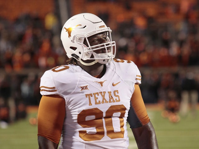 Defensive tackle Malcom Brown #90 of the Texas Longhorns looks at the video board before the game against the Oklahoma State Cowboys November 15, 2014