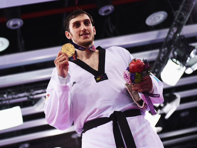 Gold medalist Radik Isaev of Azerbaijan poses during the medal ceremony for the Men's +80kg Taekwondo on day seven of the Baku 2015 European Games at the Crystal Hall on June 19, 2015