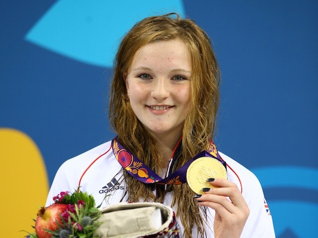 Team GB's Abbie Wood poses with her gold after winning the women's 400m medley at the European Games on June 23, 2015
