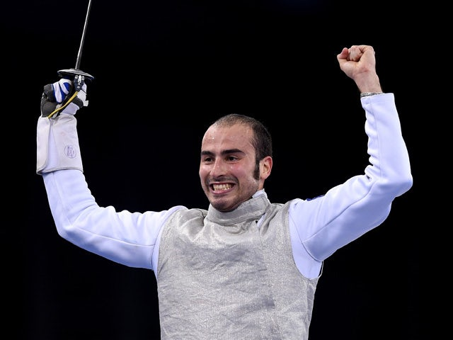 Alessio Foconi of Italy celebrates victory over Timur Arslanov of Russia in the Men's Fencing Individual Foil Final during day thirteen of the Baku 2015 European Games at the Crystal Hall on June 25, 2015