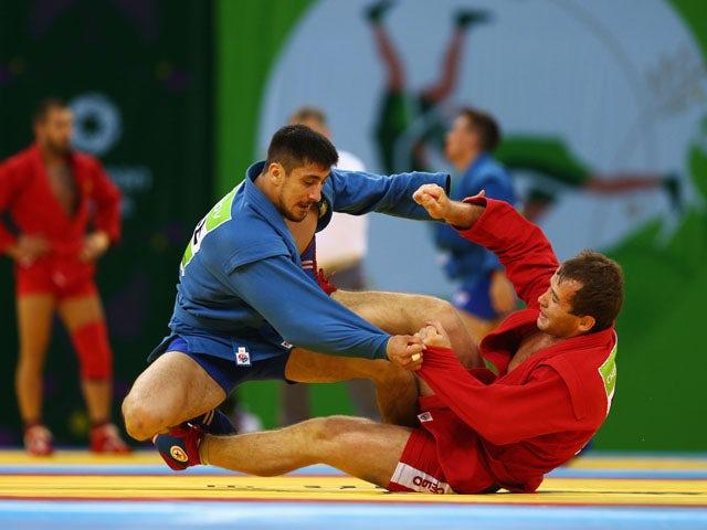 Kanan Gasimov of Azerbaijan (blue) and Alsim Chernoskulov (red) compete during the Men's Sambo -90kg semi finals during day ten of the Baku 2015 European Games at the Heydar Aliyev Arena on June 22, 2015