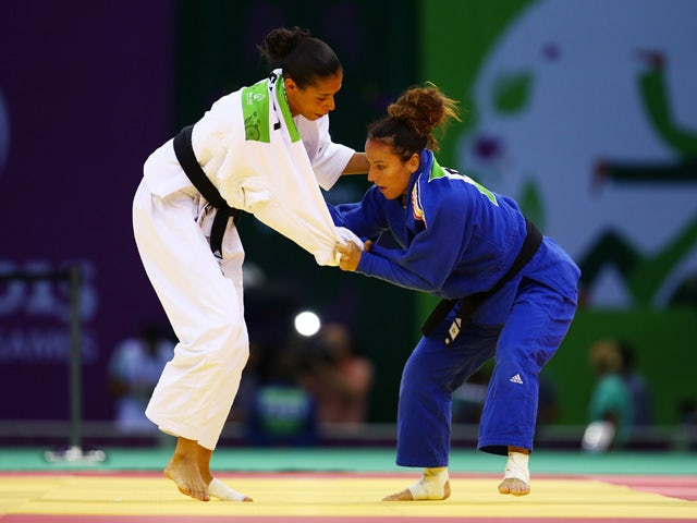 Andreea Chitu of Romania (blue) and Annabelle Euranie of France(white) compete during the Women's Judo -52kg gold medal match on day thirteen of the Baku 2015 European Games at the Heydar Aliyev Arena on June 25, 2015
