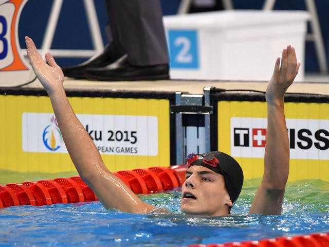 Andrii Khloptsov of Ukraine celebrates winning gold in the Men's 50m Butterfly final during day eleven of the Baku 2015 European Games at the Baku Aquatics Centre on June 23, 2015