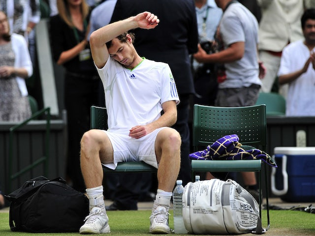 British player Andy Murray reacts after losing to Spanish player Rafael Nadal during the men's single semi final at the Wimbledon Tennis Championships at the All England Tennis Club, in southwest London on July 1, 2011