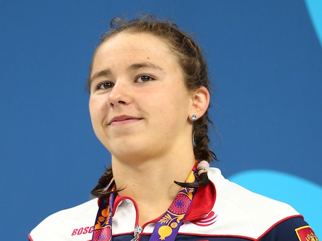 Silver medalist Arina Openysheva of Russia,stands on the podium during the medal ceremony for the Women's 100m Freestyle final during day twelve of the Baku 2015 European Games at the Baku Aquatics Centre on June 24, 2015
