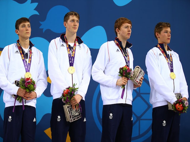 Gold medalists Cameron Kurle, Daniel Speers, Martyn Walton and Duncan Scott of Great Britain celebrate on the podium prior to receiving the medals won during the Men's 4 x 100m Freestyle Relay final during day eleven of the Baku 2015 European Games at the