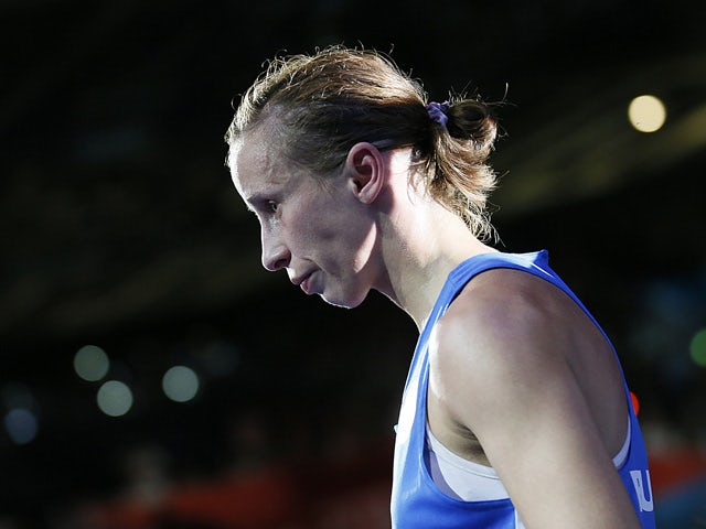 Elena Savelyeva of Russia exits the ring following her loss on points to Cancan Ren of China in the women's flyweight (51kg) boxing quarterfinals of the 2012 London Olympic Games at the ExCel Arena August 6, 2012