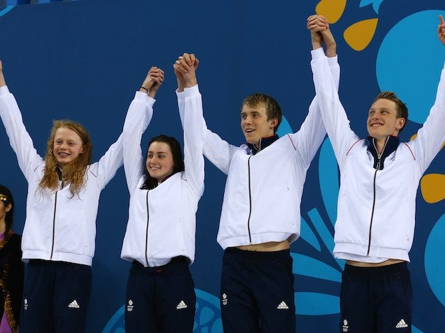 Team GB swimmers Georgia Coates, Amelia Clynes, Charlie Attwood and Luke Greenbank celebrate claiming silver in the mixed 4x100m medley at the European Games on June 26, 2015