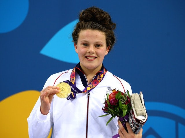 Holly Hibbott poses with her gold medal after winning the women's 800m freestyle for Great Britain at the European Games on June 23, 2015