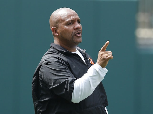 Offensive coordinator Hue Jackson of the Cincinnati Bengals looks on during an organized team activity (OTA) workout at Paul Brown Stadium on June 3, 2014