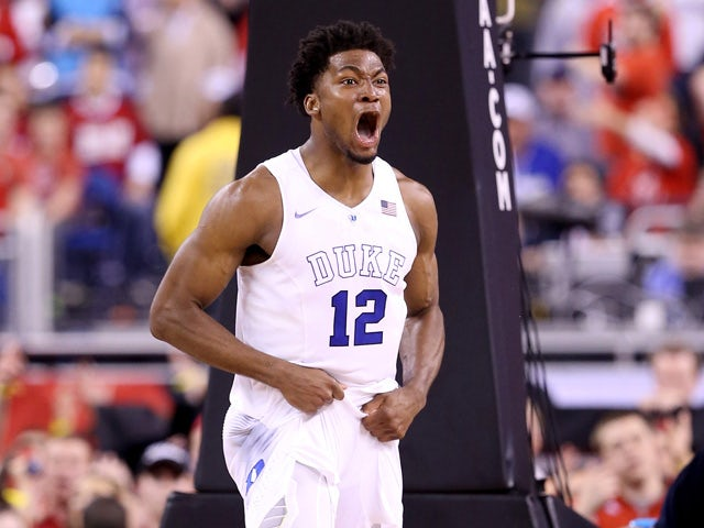 Justise Winslow #12 of the Duke Blue Devils reacts after a play in the second half against the Wisconsin Badgers during the NCAA Men's Final Four National Championship at Lucas Oil Stadium on April 6, 2015