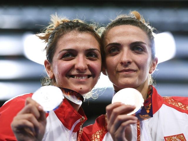 Silver medalist Sevil Bunyatova of Azerbaijan (L) and bronze medalist Sevinc Bunyatova of Azerbaijan pose on the medal podium following the Women's Fencing Individual Sabre Final during day thirteen of the Baku 2015 European Games at the Crystal Hall on J