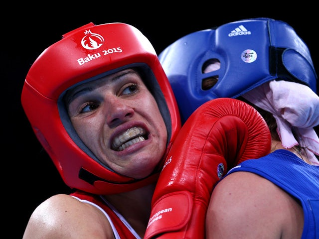 Stanimira Petrova of Bulgaria (red) and Anna Alimardanova of Azerbaijan (blue) compete in the Women's Boxing Bantamweight (51-54kg) Quarter Final during day eleven of the Baku 2015 European Games at the Crystal Hall on June 23, 2015
