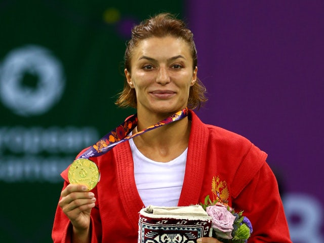 Yana Kostenko of Russia poses with her gold medal from the Women's Sambo -60kg Final during day ten of the Baku 2015 European Games at the Heydar Aliyev Arena on June 22, 2015
