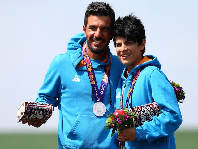 Silver medalists Georgios Achilleos and Andri Eleftheriou of Cyprus stand on the podium during the medal ceremony for the Mixed Team Skeet Shooting on day ten of the Baku 2015 European Games at the Baku Shooting Centre on June 22, 2015