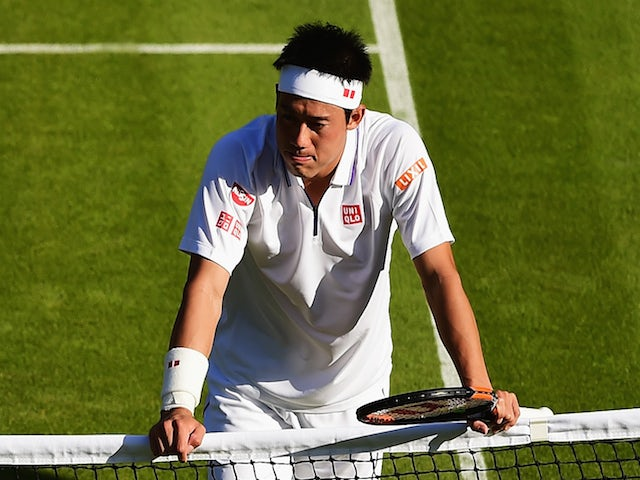 Kei Nishikori (top) of Japan reacts after winning his Gentlemen's Singles first round match against Simone Bolelli of Italy during day one of the Wimbledon Lawn Tennis Championships at the All England Lawn Tennis and Croquet Club on June 29, 2015