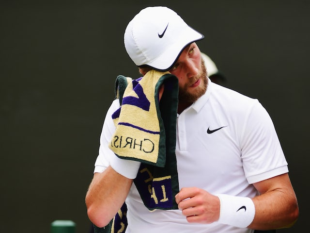 Liam Broady of Great Britain towels down between games in his Gentlemens Singles Second Round match against David Goffin of Belgium during day three of the Wimbledon Lawn Tennis Championships at the All England Lawn Tennis and Croquet Club on July 1, 2015