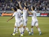 Robbie Keane #7 of Los Angeles Galaxy celebrates his hat-trick with teammates after scoring his third goal of the game against Toronto FC on July 4, 2015