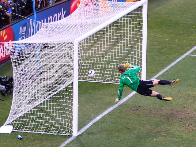 Manuel Neuer of Germany watches the ball bounce over the line from a shot that hit the crossbar from Frank Lampard of England, but referee Jorge Larrionda judges the ball did not cross the line during the 2010 FIFA World Cup South Africa Round of Sixteen