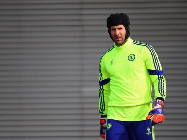 Petr Cech looks on during a Chelsea training session ahead of the UEFA Champions League Round of 16 second leg match against Paris Saint-Germain at Chelsea Training Ground on March 10, 2015