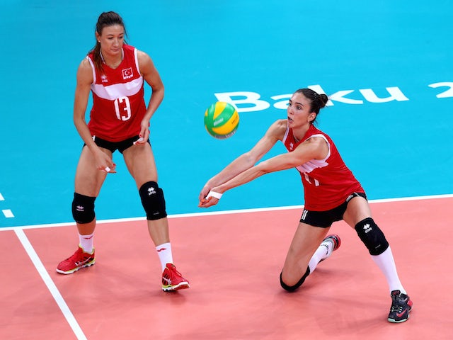 Neriman Ozsoy (13) and Naz Aydemir Akyol (11) of Turkey in action during the Women's Volleyball gold medal match between Turkey and Poland on day fifteen of the Baku 2015 European Games at the Crystal Hallon June 27, 2015