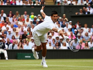 Djokovic retires, Berdych through to semis
