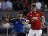 Bastian Schweinsteiger #23 of Manchester United dribbles the ball as Tommy Thompson #22 of San Jose Earthquakes defends during the second half of their International Champions Cup match on July 21, 2015