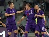 Federico Bernardeschi with his teammates of ACF Fiorentina celebrates after scoring the opening goal during the preseason friendly match between ACF Fiorentina and FC Barcelona at Artemio Franchi on August 2, 2015