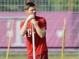 Bayern Munich's Spanish midfielder Xabi Alonso waits ahead the training of the German first division Bundesliga team FC Bayern Munich at the team club area in Munich, southern Germany, on July 7, 2015