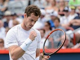 Andy Murray of Great Britain reacts after scoring a point on Gilles Muller of Luxembourg during day four of the Rogers Cup at Uniprix Stadium on August 13, 2015