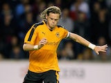 Richard Stearman of Wolverhampton Wanders passes the ball during the pre season friendly between Wolverhampton Wanderers and Aston Villa at Molineux on July 28, 2015