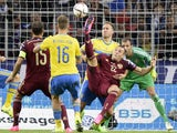 Russia's forward Artem Dzyuba (C) attacks Sweden's net during their UEFA Euro 2016 qualifying round Group G football match between Russia and Sweden at Otkrytie Arena in Moscow on September 5, 201