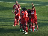 Tesho Akindele #13 of FC Dallas celebrates his second half goal with his teammates against the Philadelphia Union at PPL Park on March 21, 2015 in Chester, Pennsylvania. Dallas won 2-0.