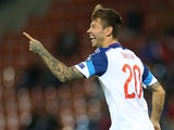 Russia's Fedor Smolov celebrates after scoring his team's fifth goal during the Euro 2016 qualifying football match between Liechtenstein and Russia at the Rheintal stadium in Vaduz on September 8, 2015