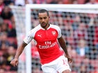 Theo Walcott of Arsenal runs with the ball during the Emirates Cup match between Arsenal and VfL Wolfsburg at the Emirates Stadium on July 26, 2015