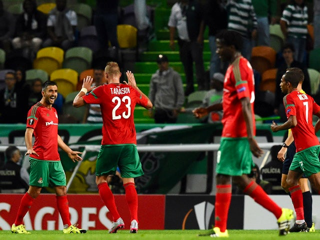 Lokomotiv's midfielder Aleksandr Samedov (L) celebrates after scoring a goal during the UEFA Europa League group H football match Sporting CP vs Lokomotiv Moskva at the Jose Alvalade stadium in Lisbon on September 17, 2015