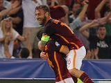 Alessandro Florenzi (L) with his teammate Daniele De Rossi of AS Roma celebrates after scoring the team's first goal during the UEFA Champions League Group E match between AS Roma and FC Barcelona at Stadio Olimpico on September 16, 2015