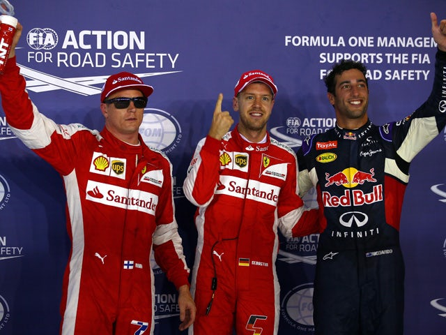 Sebastian Vettel of Germany and Ferrari celebrates in Parc Ferme next to Daniel Ricciardo of Australia and Infiniti Red Bull Racing and Kimi Raikkonen of Finland and Ferrari after claiming pole position during qualifying for the Formula One Grand Prix of