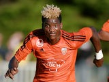 Lorient's Gabonese midfielder Didier Ndong runs with the ball during the friendly football match between Nantes (FCN) and Lorient (FCL) on July 22, 2015 at the Moreau-Desfarges stadium in La Baule-Escoublac, western France.
