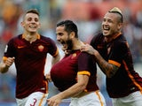 Kostas Manolas (C) of AS Roma celebrates Lucas Digne (L) and Radja Nainngolan after scoring the opening goal during the Serie A match between AS Roma and Carpi FC at Stadio Olimpico on September 26, 2015 in Rome, Italy.