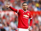 Chris Smalling of Manchester United gives instructions during the Barclays Premier League match between Manchester United and Newcastle United at Old Trafford on August 22, 2015 in Manchester, United Kingdom.