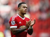 Memphis Depay of Manchester United celebrates his team's 3-0 win in the Barclays Premier League match between Manchester United and Sunderland at Old Trafford on September 26, 2015 in Manchester, United Kingdom.