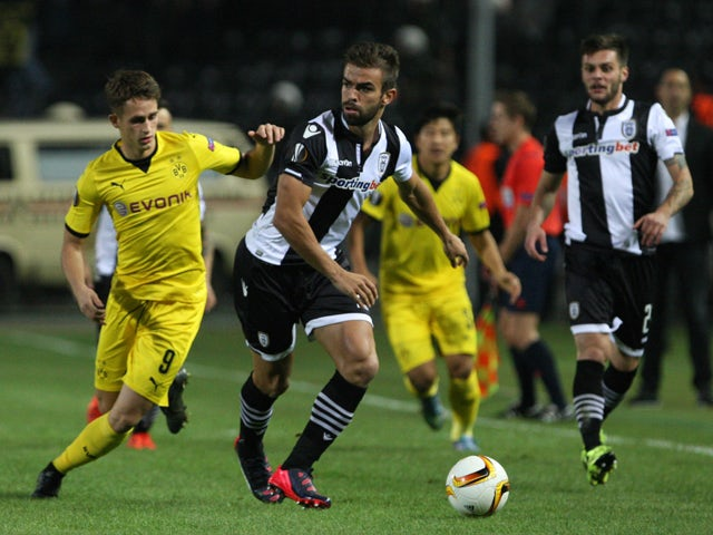 Dortmund's Adman Januzaj (L) and Paok's Miguel Vitor (C) vie during the UEFA Europa League football match PAOK FC Thessaloniki vs Borussia Dortmund at Toumpa stadium in Thessaloniki on October 1, 2015