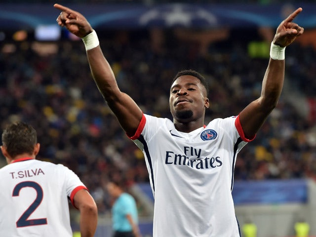 Paris Saint-Germain's Ivorian defender Serge Aurier celebrates after scoring a goal during the UEFA Champions League group A football match between Shakhtar Donetsk and Paris Saint-Germain at the Arena Lviv, in the Ukrainian city of Lviv, on September 30,