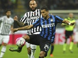 Jeison Murillo of FC Internazionale Milano competes for the ball with Simone Zaza (back) of Juventus FC during the Serie A match between FC Internazionale Milano and Juventus FC at Stadio Giuseppe Meazza on October 18, 2015