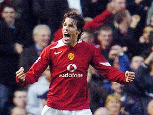 Manchester United's Ruud Van Nistelrooy celebrates scoring a penalty kick against Arsenal during their Premiership football match at Old Trafford, Manchester, United Kingdom, 24 October 2004