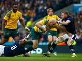 Stephen Moore of Australia is tackled by David Denton (L) and Finn Russell of Scotland during the 2015 Rugby World Cup Quarter Final match between Australia and Scotland at Twickenham Stadium on October 18, 2015 in London, United Kingdom.