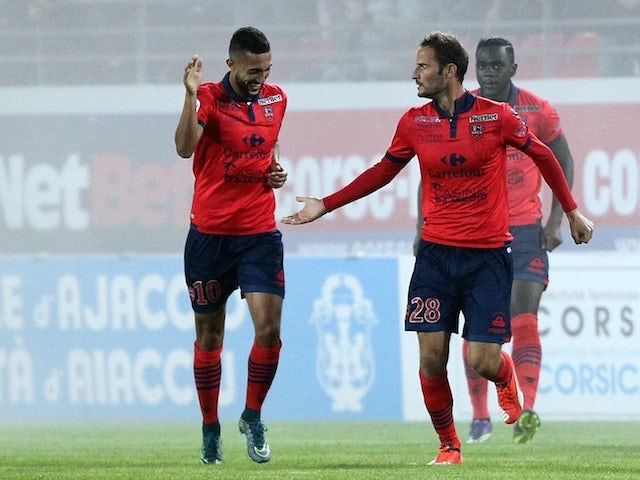 Ajaccio's French forward Gregory Pujol (2ndR) is congratulated by teammates after scoring a goal during the French L1 football match between Gazelec Ajaccio (GFCA) and Nice (OGCN) on October 24, 2015, at the Ange Casanova stadium in Ajaccio, on the French