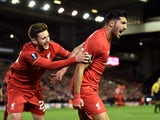 Emre Can (R) of Liverpool is congratulated by teammate Adam Lallana of Liverpool after scoring a goal to level the scores at 1-1 during the UEFA Europa League Group B match between Liverpool FC and Rubin Kazan at Anfield on October 22, 2015